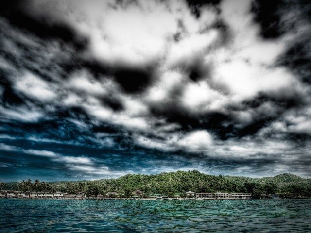 Coastal Stormy Clouds Over Town Wallpaper