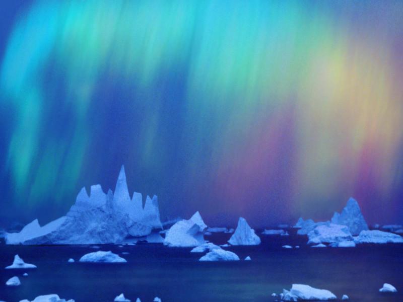 Aurora Australis (southern Light) Over Icebergs
