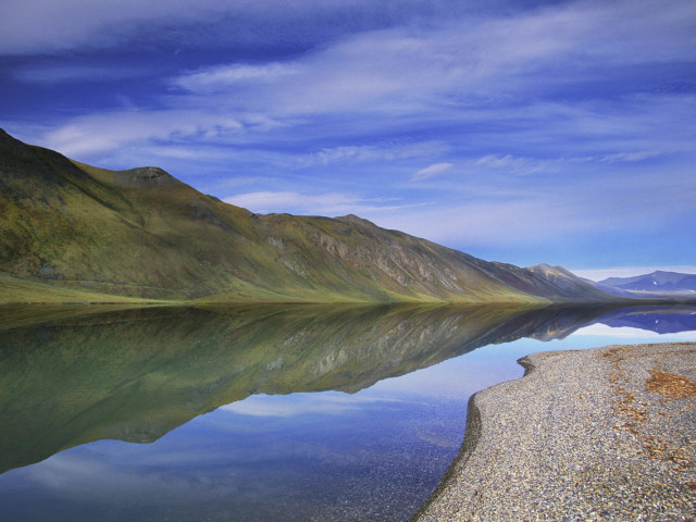 An Extremely Rare, Calm Day Brings Almost Perfect Reflections To The Surface Of Lake Peters In Alaska's Arctic National Wildlife Refuge.