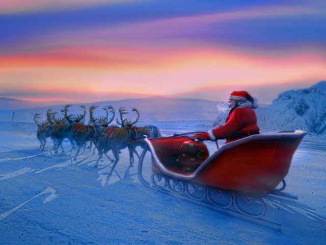 Santa Riding Sleigh Wallpaper